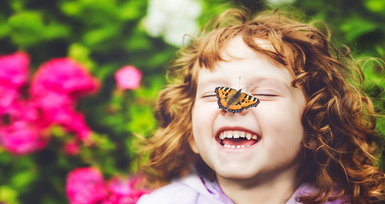 Kid playing with butterfly